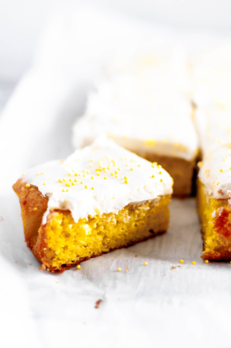 This Easy Lemon Cake with Cream Cheese Frosting starts with a boxed cake mix and a few extras to make a moist, dense, extra lemony cake that is a snap to mix up. Top it with this thick, tangy cream cheese frosting for the perfect welcome to spring.