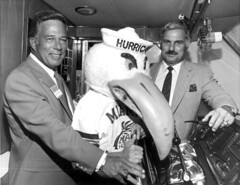 University of Miami head football coach Howard Schnellenberger, right, posing with Don Works and the school mascot for group portrait: Fort Lauderdale, Florida
