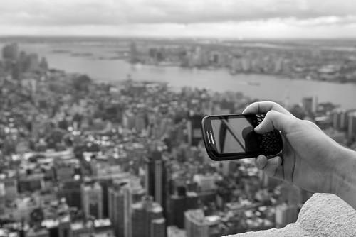 nyc newyorkcity blackandwhite usa newyork reflection clouds hand view unitedstates manhattan unitedstatesofamerica photographers cellular depthoffield motorola mobilephone hudsonriver empirestatebuilding
