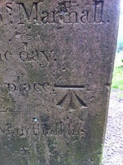 Bench mark on a grave stone detail