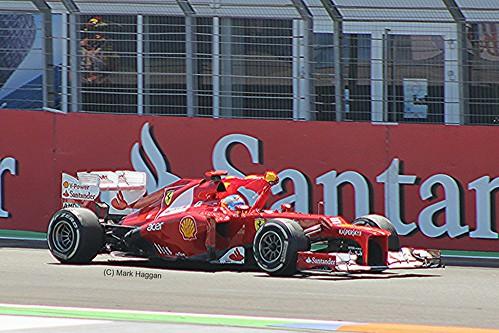 Fernando Alonso celebrates after winning the 2012 European Grand Prix in Valencia