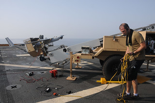 A contractor prepares a Scan Eagle unmanned ae...