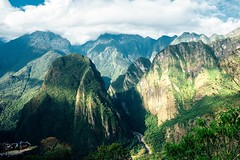 Mountains off to the side of Machu Picchu. Imagine falling asleep with this view every night. #theworldwalk #travel #peru
