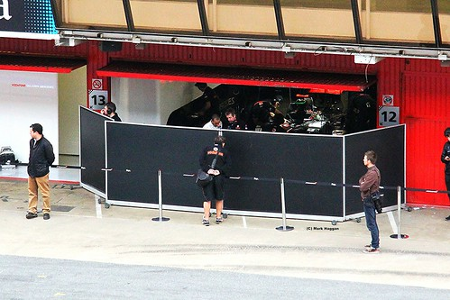 Lewis Hamilton in the McLaren garage with his engineers at Formula One Winter Testing, Circuit de Catalunya, March 2012