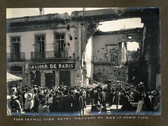 Peon crowds view havoc wrought by war in their...