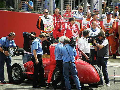 Fernando Alonso drives a historic Ferrari at the 2011 British Grand Prix