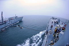 USS McCampbell prepares to receive fuel from a...
