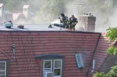 Firemen On The Roof
