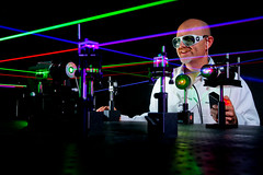 An electronics engineer uses visible lasers to...