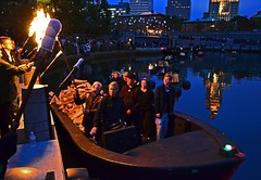 Rocco Landesman, Chairman of the National Endowment for the Arts, receives the flame to lite WaterFire