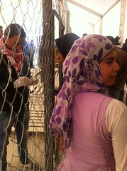 Women refugees from Syria queue to register on...