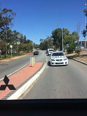 Police vehicles behind bus