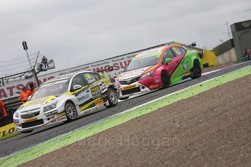 Hunter Abbott and Michael Epps in race two during the BTCC weekend at Knockhill, August 2016