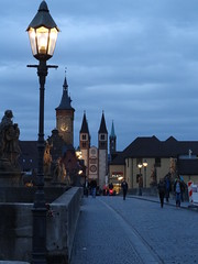 Alte Mainbruecke with the towers of St Killian's at the end of the street