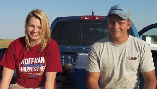 Hattie and Montana eat supper on the tailgate