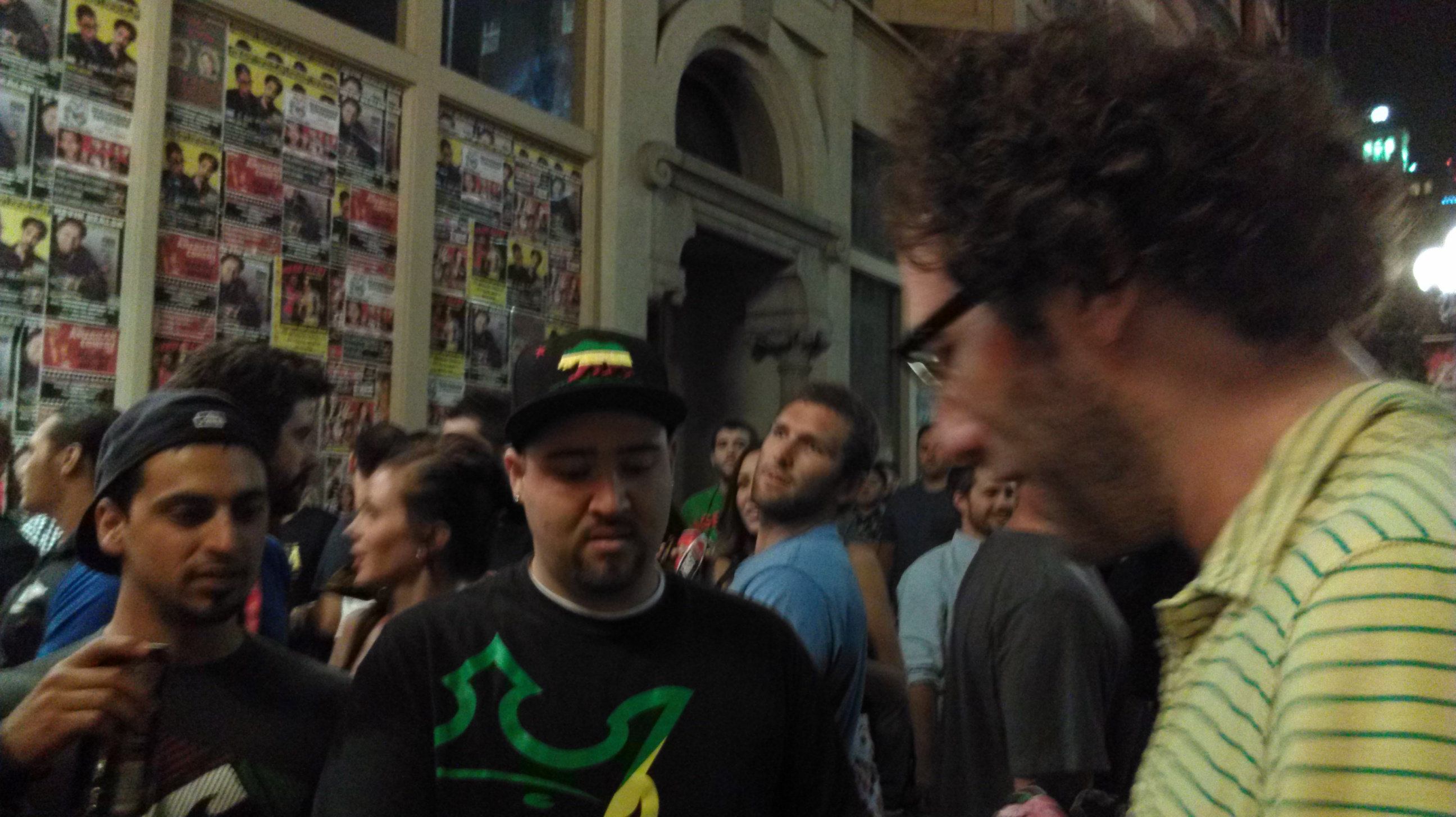Ari Shaffir and I were slinging shirts out front.