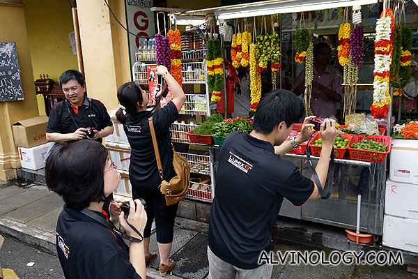 Taking pictures of the flower garlands