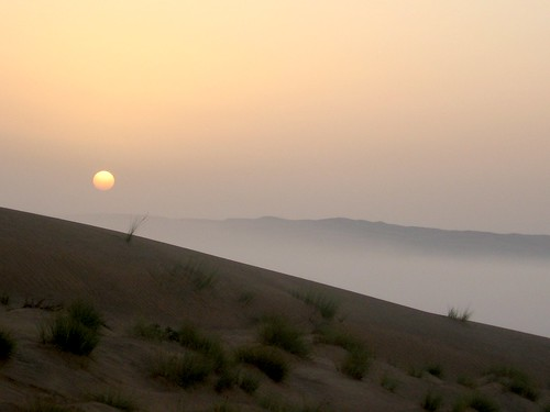 Sunrise and mist over the Wahiba