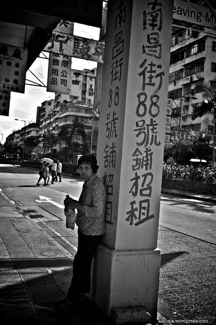 Lady by a column in Sham Shui Po