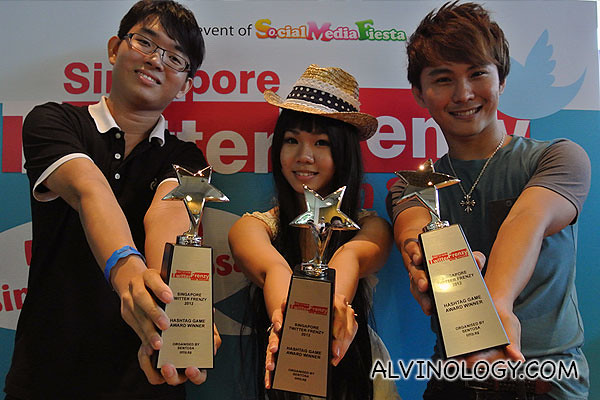 The three winners with their beautiful trophies