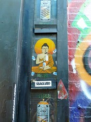 Buddha with spray cans