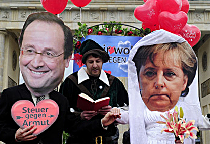 12e08 Hollande Merkel Foto John MacDanball AFP Getty Uti