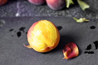 slipping the peach skins off