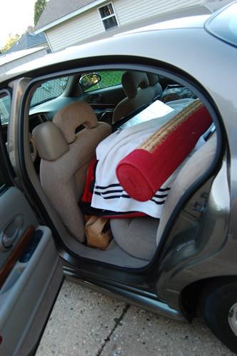 Door open to show packed back seat of Aaron's car