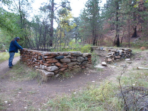 9-26-12 CO - Hewlett Gulch Hike22, Dave inspects rock wall on Homestead Foundation