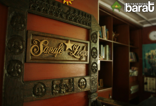 Sanafe's logo wood carving