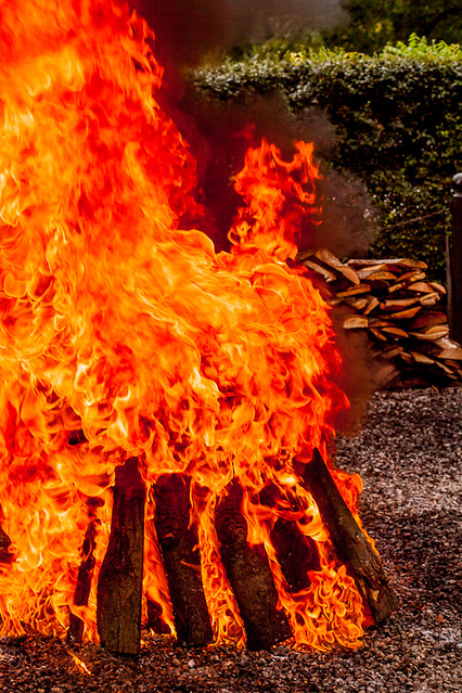 Traditional Fish Boil - Adding Kerosene to Fire