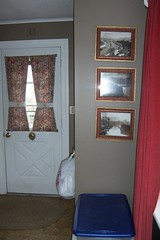 Three Sutcliffe photos framed.