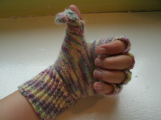 thumbs-up in a podster glove