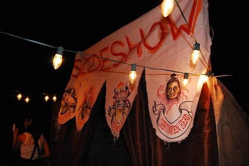 ari and christian's fall carnival wedding sideshow booth
