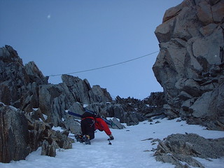 Climbing over rocks to get into the couloir