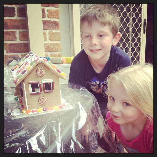 Cousins and a gingerbread house