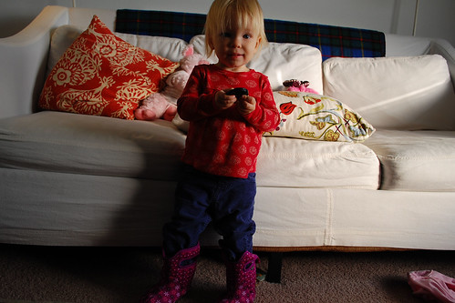 Wearing sister's boots.