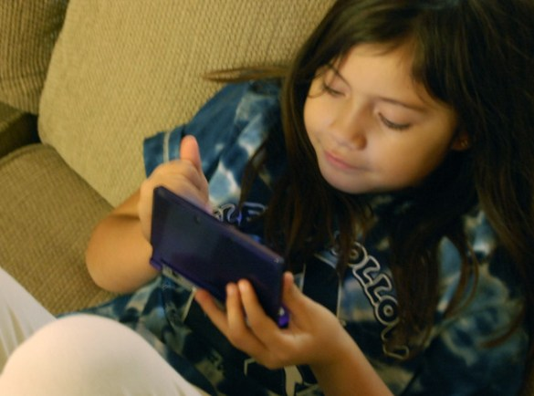 Playing with her Nintendo 3DS