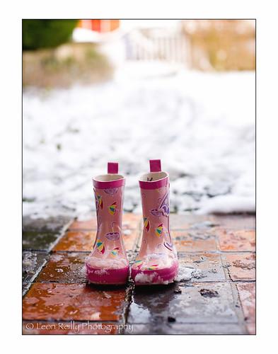 Pink snowy wellies at the door.