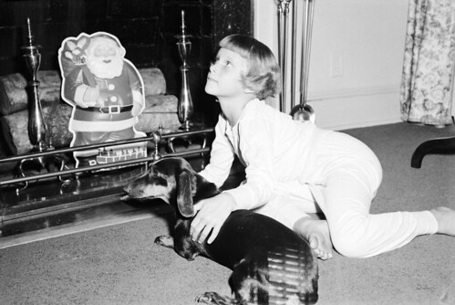 Child and Dog Wait for Santa Claus by Fireplace, Rocky Mount, NC, 1955