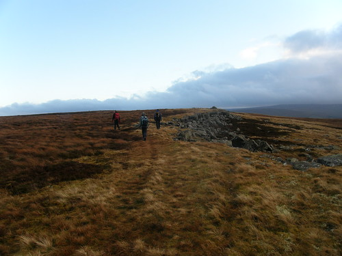 Approaching the modest cairn