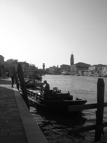 Venice canal with boat in shadows