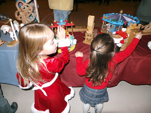 playing with the handmade wooden toys