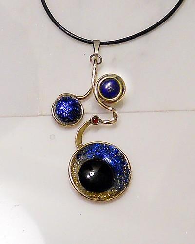 pendant nugold, brass,lapis lazuli 10mm,onyx18mm,ruby synth 4mm,epoxy, glitter, pigment by Wolfgang Schweizer