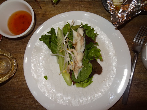 Fish and herbs in rice paper roll