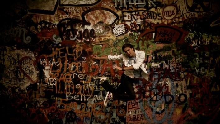 Jumping in Front of John Lennon Wall in Prague