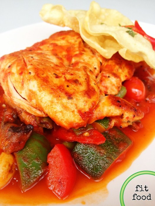 Chicken fricassee on a bed of cumin-roasted ratatouille, topped w thin papadam crisps