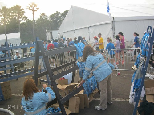 Volunteers handing out medals