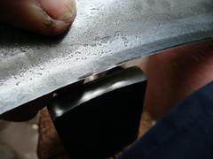 Hammer contact on scythe edge
