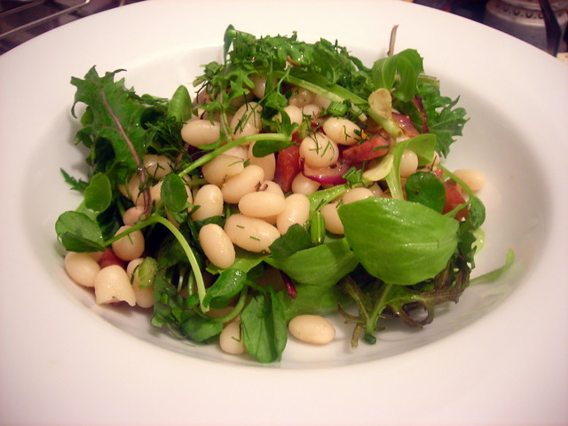 Navy bean and baby mesclun salad, with pancetta and red onion